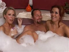 Two milfs in the hot tub with lucky guy tubes