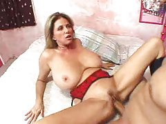 Big tits and sexy boots on milf slut tubes