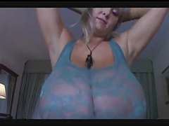Girl with humongous natural tits modeling them tube