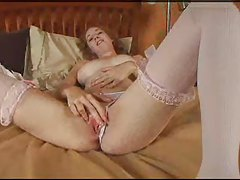 Redhead toy and finger play in bed tubes