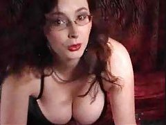 Hot glasses girl on webcam uses two toys tubes