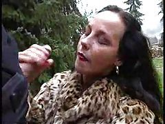 Chick in fur coat giving handjob outdoors tubes