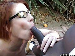 Redhead in glasses eating black cock tubes