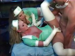 Two naughty latex nurses fucked by patient tubes