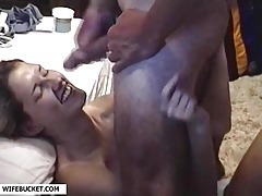 He strokes and sprays a big load on her tubes