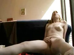 She strips and masturbates on the couch tubes