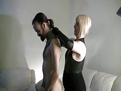 Dude suffers for the domme in leather tube