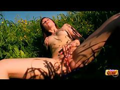 Teen in a field of flowers masturbating tubes
