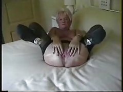 Granny models her welcoming pussy hole tubes