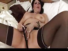 Mature lady pushes toy into her pussy tubes