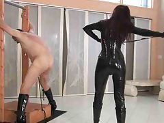 Gal in latex catsuit whips her man hard tubes