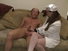 Clothed gal giving his cock a handjob tubes
