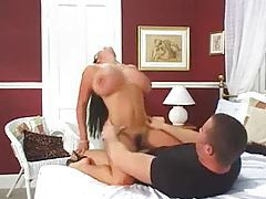 Heavy breasted hottie gets on top to bounce tubes