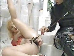 Dominatrix in black pisses on her submissive girl tubes