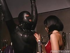 Girl has fun playing with rubber bondage slave tubes