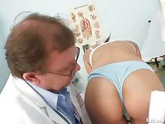 Girl in stockings and schoolgirl skirt examined tubes