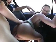 Car is driving while chick gets fucked tubes