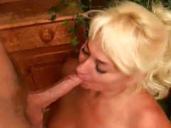 Mature blonde calls man over for head tubes