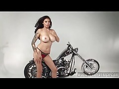 Tera Patrick posing topless by the bike tubes