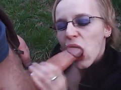 Chick in glasses sucks dick outdoors tubes