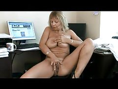 Mature in her office poses in pantyhose tubes