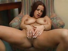 Busty brunette girl rubs and fingers tubes