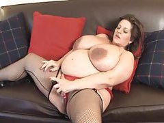 Fat mature in stockings fucks cunt with toy tube