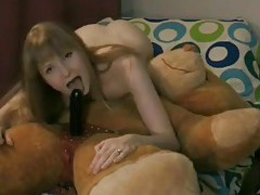Amateur rides strapon attached to her teddy bear tubes