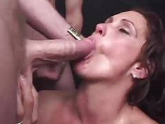 Milf surrounded by cocks sucks tubes