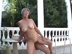 Granny plays with old and young outdoors tubes
