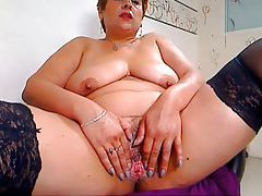 Chubby mature shows her pink pussy tubes