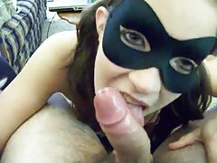 Girl in a mask deepthroats a cock tubes