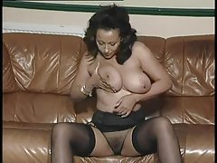 Glamorous and well dressed milf strips tubes