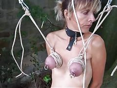 Outdoor bondage where she hangs by her tits tubes