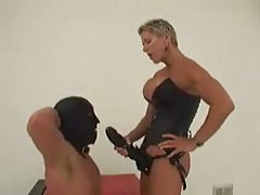 Dominant chick with huge strapon fucks slave tube