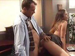 Young lady in a dress has sex at the office tubes