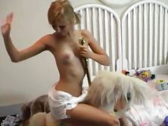 Girl in a diaper in her bedroom tubes