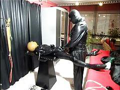 Kinky latex and leather play in dungeon tubes