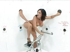 Claire Dames in gloryhole room blows tubes