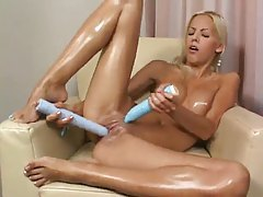 She oils up her body and plays with toys tubes