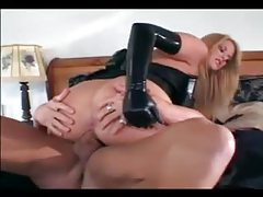 Latex lady gets in bed and fucks hard tubes