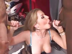 Cocksucker in lingerie blows guys in warehouse tubes