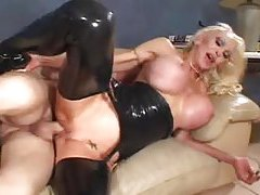 Huge titty slut in black latex fucked tubes