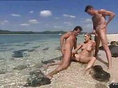 Two guys cum on a slut on the beach tubes