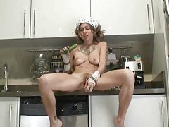 Heavily tattooed hot body girl fucks a veggie tubes
