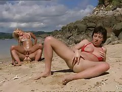 Fucking two hot sluts on the beach tubes