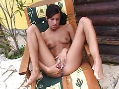 Skinny girl fingers and strips outdoors tubes