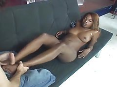 Black gal gives one hell of a footjob tubes