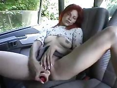 Toy sex for redhead in the car tubes