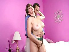 Mature in green satin lingerie teases tubes